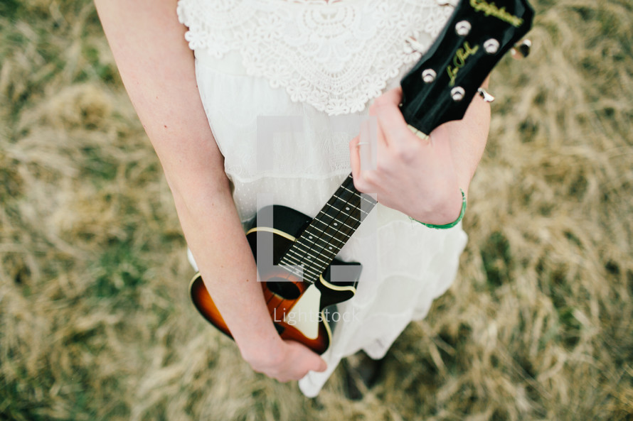 a woman holding a guitar