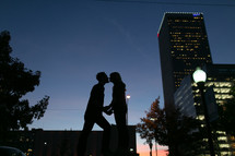 Couple kissing at sunset in the city