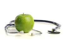 stethoscope and a green apple