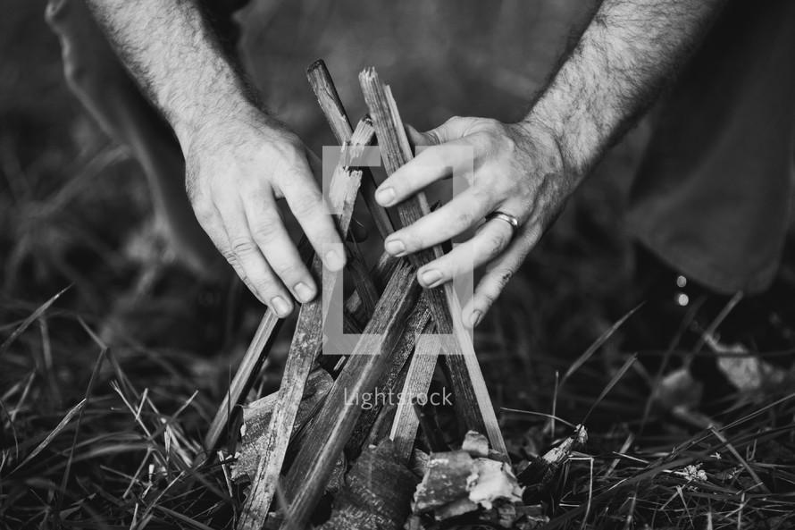 a man starting a campfire