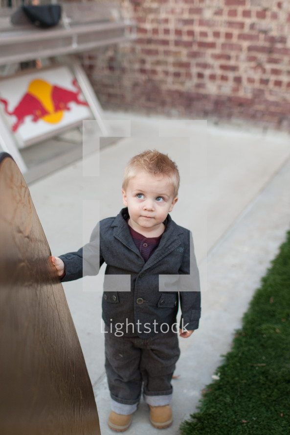 toddler boy looking up