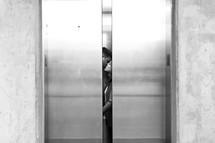 Couple kissing in elevator
