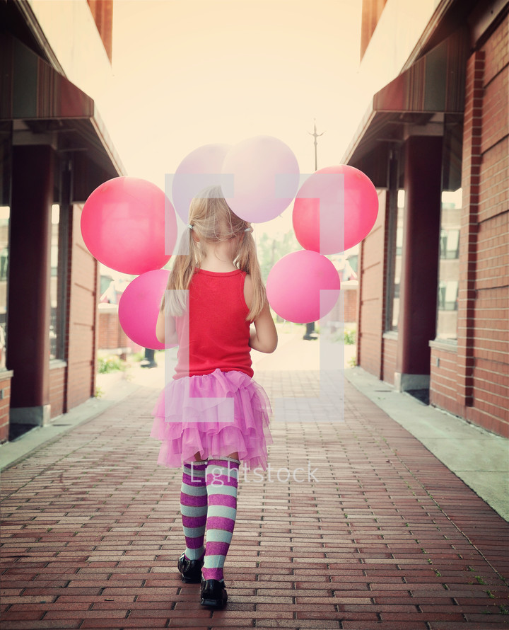 a little girl with balloons