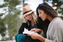 friends reading a Bible together outdoors