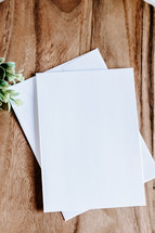 white paper and envelope on a wooden tray