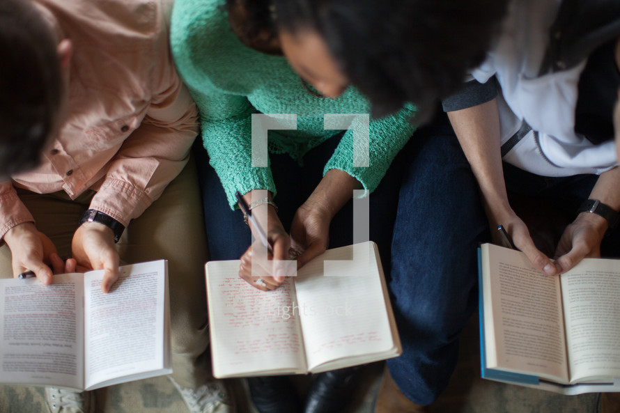 a woman writing in a journal at a Bible study