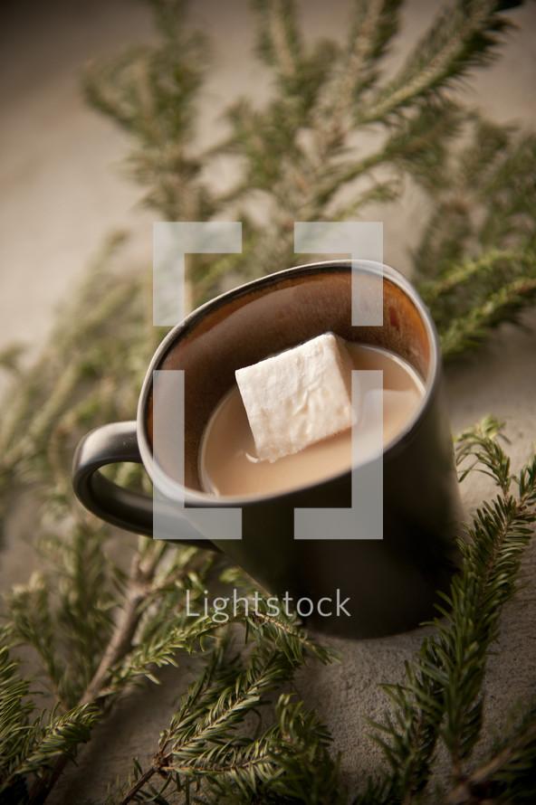 sugar cube in a coffee mug