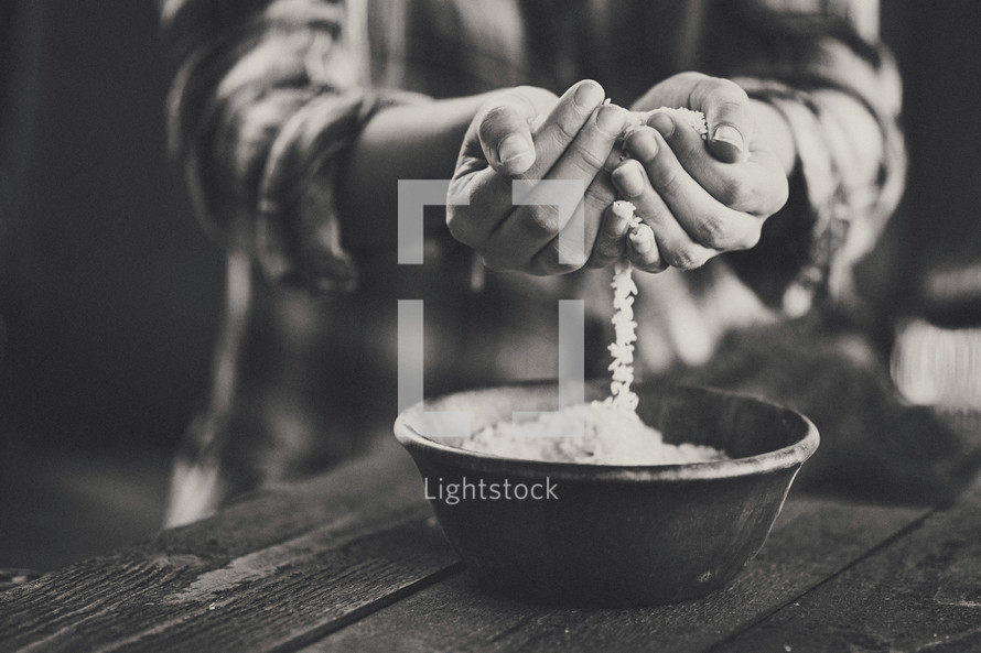 cupped hands holding rice