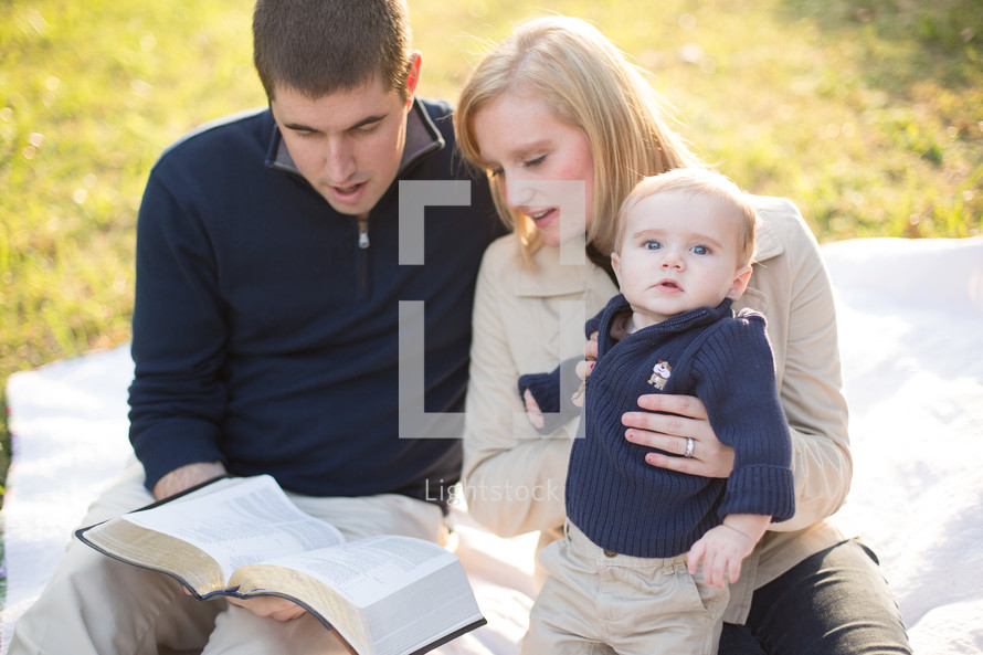 family sitting together reading the Bible