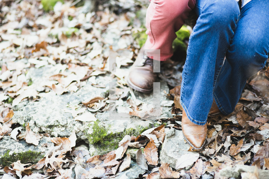 a couples feet on fall leaves