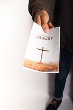 "A person holding out a pamphlet entitled, ""Do You Know Jesus?"""