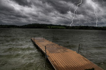 lightning over a lake and floating dock