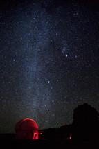 telescopes under stars in the night sky