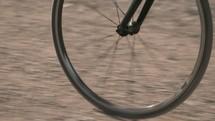 bike wheel on a dirt road