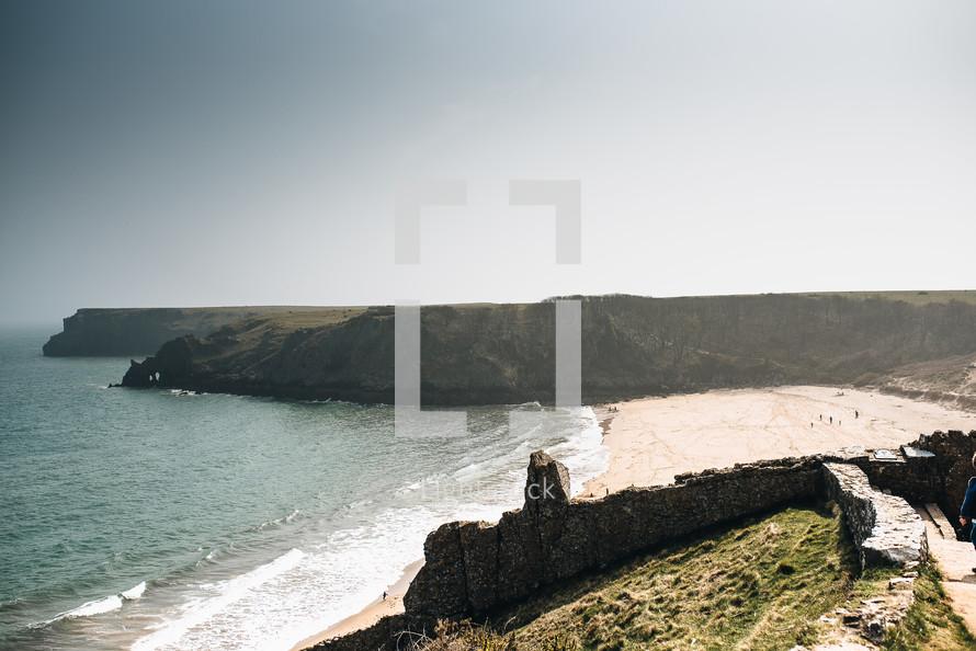 fortress walls in ruins along a shoreline