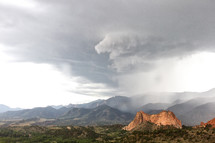 storm clouds over Colorado Springs and Gray rock at Garden of the Gods