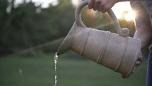 pouring water from a pitcher