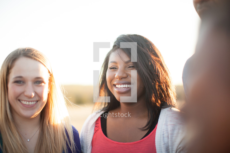 smiling young women outdoors