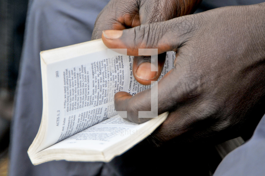 Hands holding a Bible.