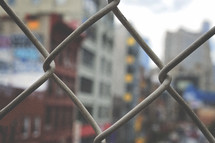 chain link fence and view of buildings