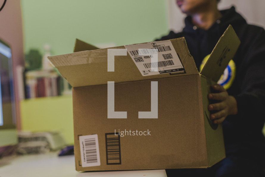 boxing up an Amazon package