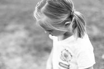 little blonde girl in pigtails