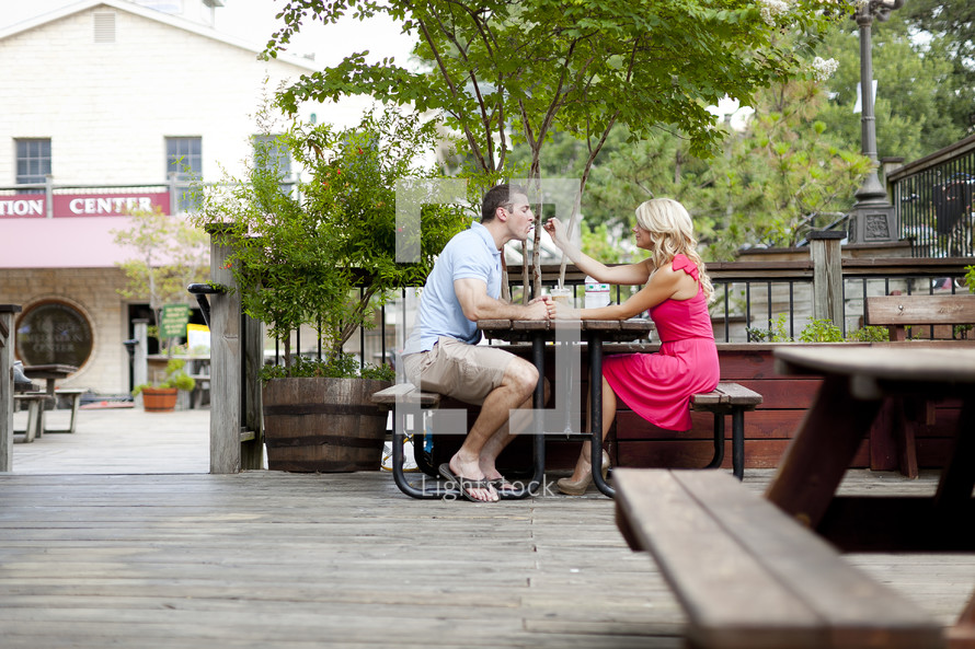 A couple eating lunch on a patio
