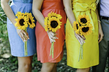 Women holding sunflowers