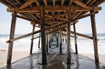 support posts under a pier