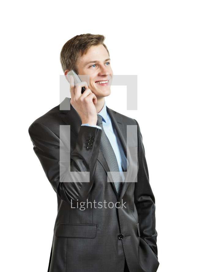 Successful businessman with a cell phone.