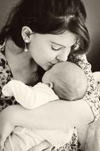 mother kissing her infant