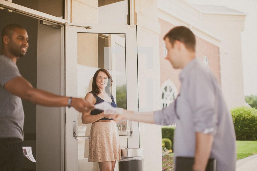 greeters welcoming church parishioners