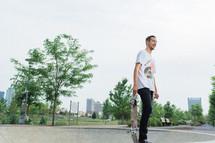 Man holding a skateboard.