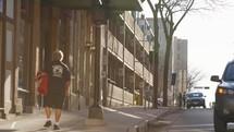 pedestrians walking on a city sidewalk
