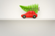 toy car with Christmas tree on its roof