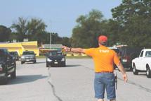 man directing parking traffic