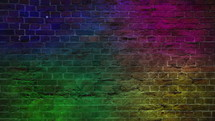 colorful strobe lights against a brick wall