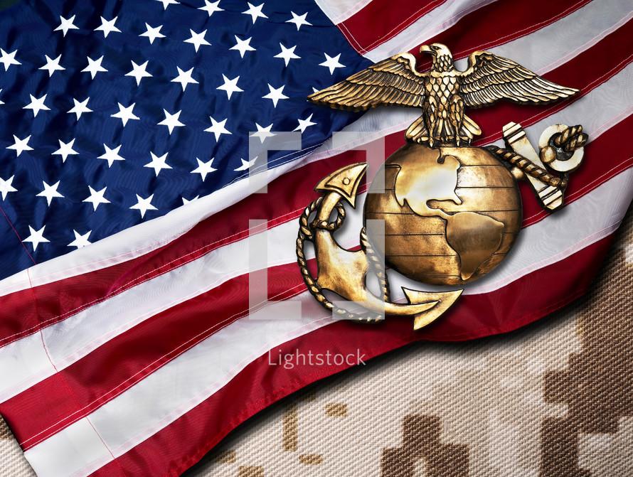 American flag and bronze marine seal