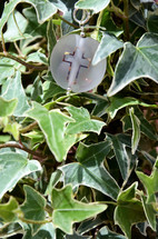 cross necklace on ivy