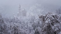 falling snow and a castle on a hill