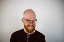 headshot of a smiling man