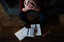a distressed man reading a Bible for comfort