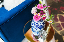 pink flowers in a blue and white vase