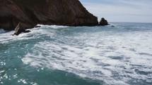 rocky cliffs along a shoreline