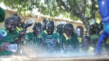 children in Kenya celebrating with purified water