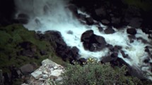 Water rushing over rocks in a stream.