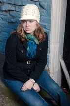 woman in a toboggan and scarf sitting