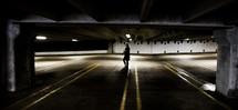 woman walking in a parking deck