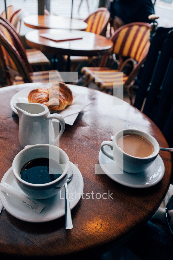 coffee and croissants on a table in a cafe