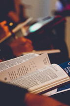 Bible in a lap at a worship service